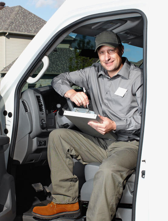 photo of a moving worker sitting in his van signing documents