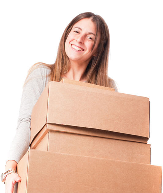 photo of a smiling woman carrying stacked boxes