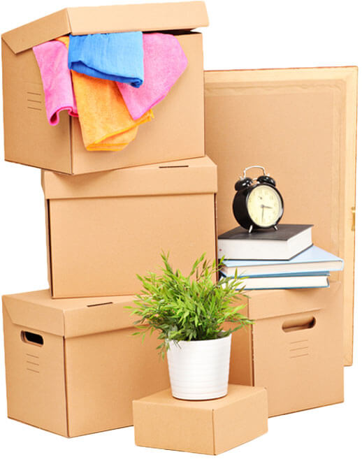 photo of boxes filled with house items stacked on top of each other